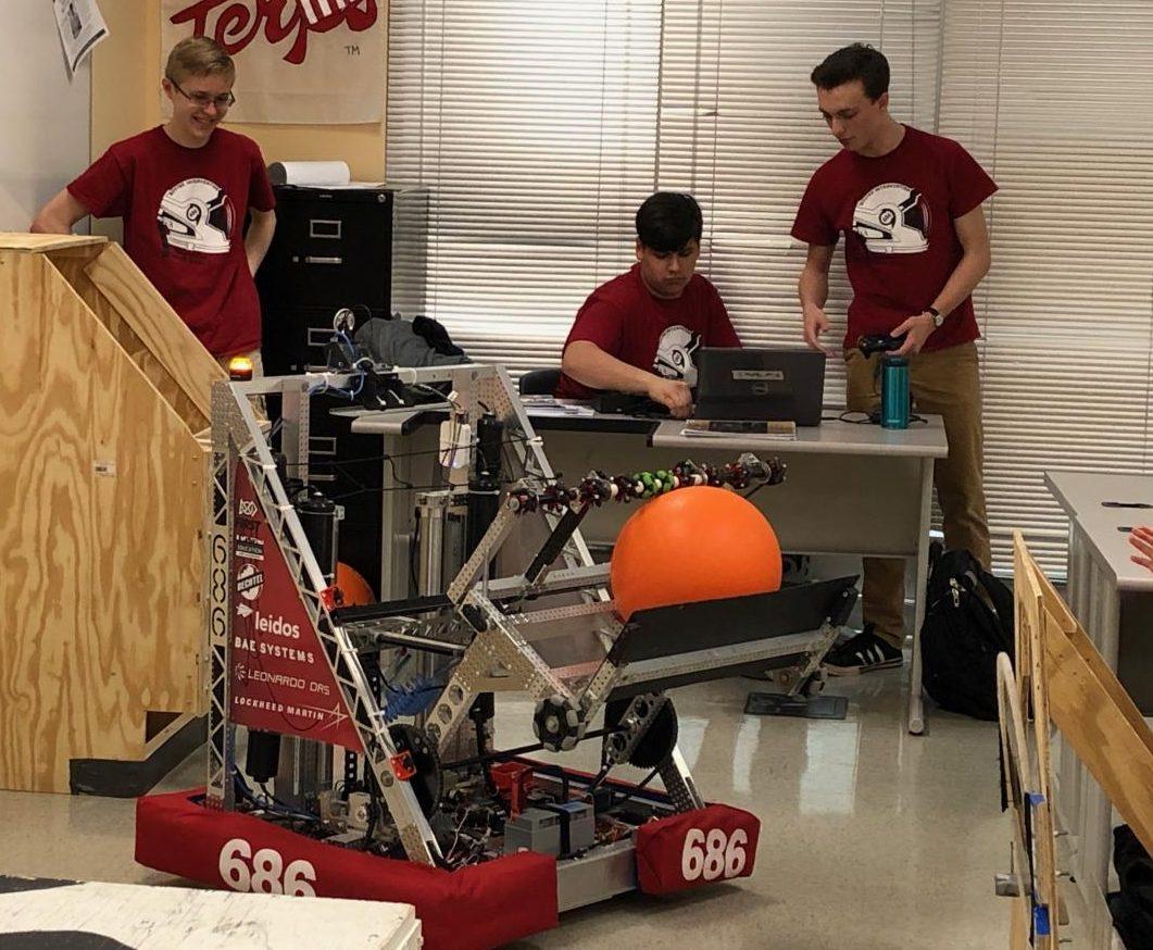 Team 686 shows off their newest robot for Greene's POE class.