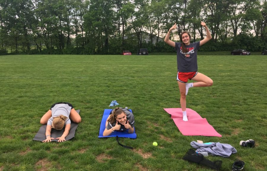 Sammie+Hoefs%2C+Elizabeth+Rajnik%2C+and+Keri+Horine+pose+in+their+favorite+yoga+forms.