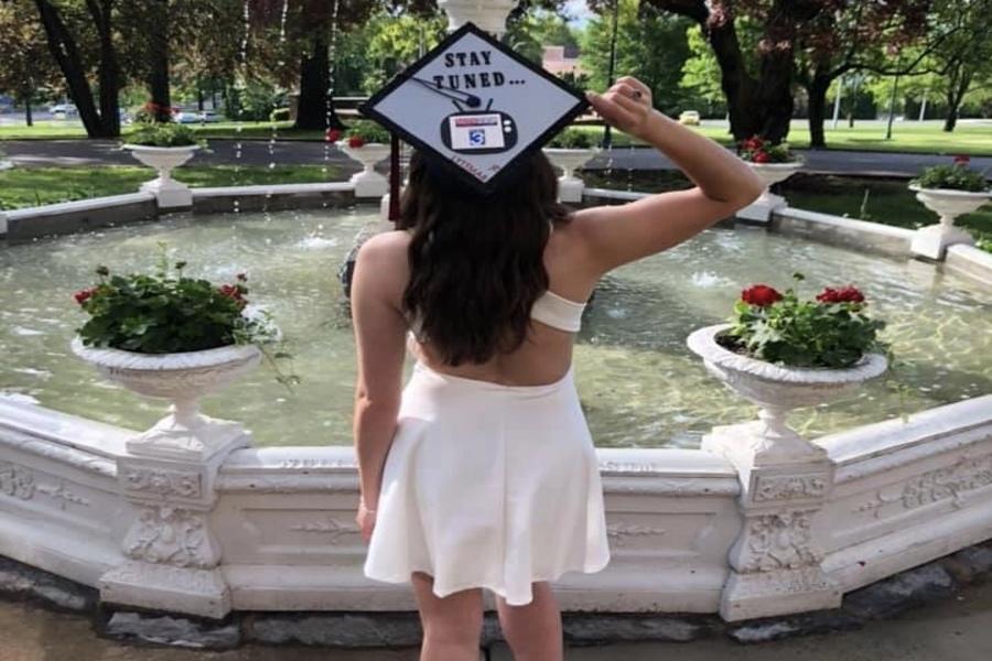 Linganore alumni Isabella Marcellino showcasing her future broadcasting career at her Shippensburg graduation.