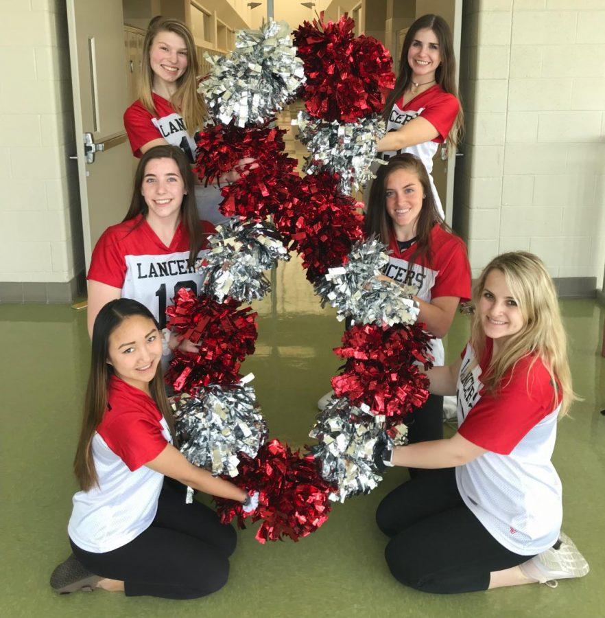 Pom and Dance seniors, Cici Emerson, Cailey Weber, Kaley Henyon, Grace Winpigler, Haley Stone, and Emily Schumate, show their love for Poms.