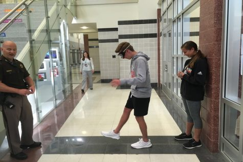 Students fall over for drunk goggles: Photo of the Day 5/17/19