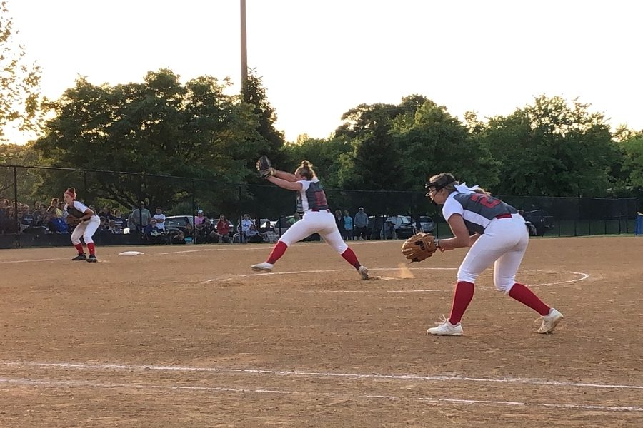 Class+of+2021+and+pitcher+Jenna+McLain+pitches+a+strike+in+the+state-semifinal+game%2C+while+class+of+2022+Claire+Thomas+plays+first+base+and+class+of+2019+Annabelle+Stone+plays+third+base.