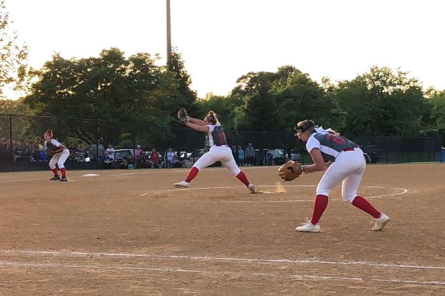 Class of 2021 and pitcher Jenna McLain pitches a strike in the state-semifinal game, while class of 2022 Claire Thomas plays first base and class of 2019 Annabelle Stone plays third base.