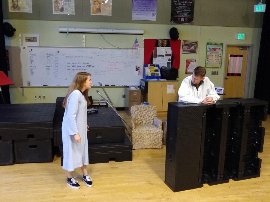 Mackenzie Berry and Rowan Gallagher perform a scene from Julius Caesar.