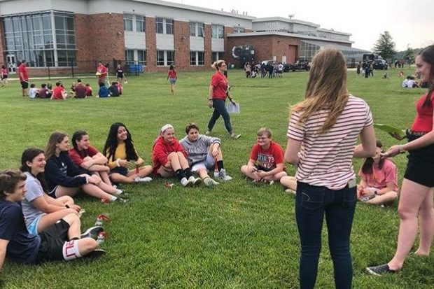 Junior Katie Roach and freshman Maeve Smarick lead the future Lancers in a group discussion.