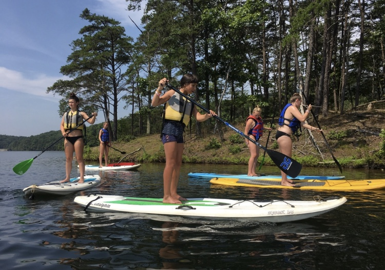 Madeline+Hull+and+friends+take+a+paddlboarding+lesson+while+on+vacation+in+Virginia.