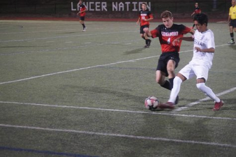 Boys soccer falls short in thrilling encounter against Urbana
