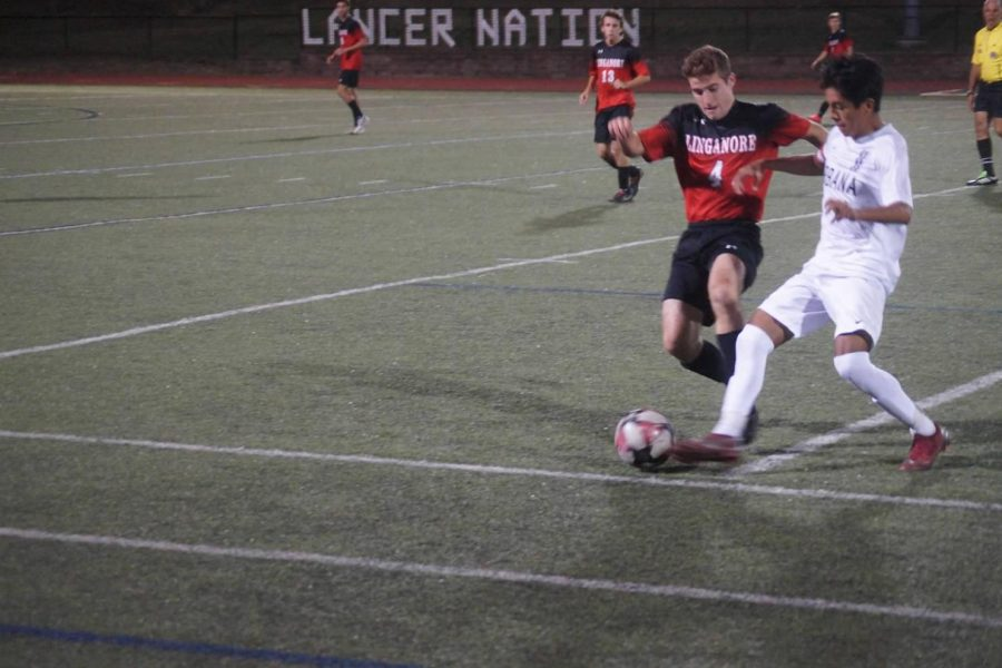 Midfielder Colin Choudhary (left) and Urbana goalscorer Nick Narvaez (right) contest for the ball
