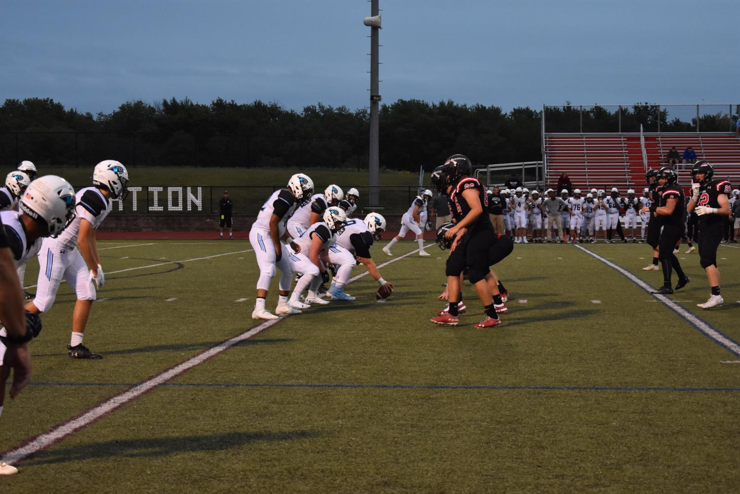 The Lancers' defense lines up just before the Owls hike the ball.