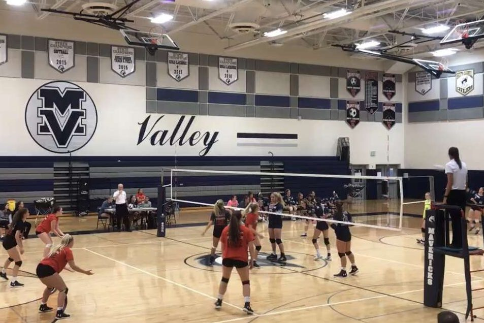 Girls volleyball prepares for a serve against Manchester Valley.