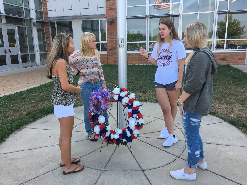 Students Grace Gaydosh, Alaina Burger, Kendall Marti, and Leah Bolger visit the 9-11 wreath to pay their respects.