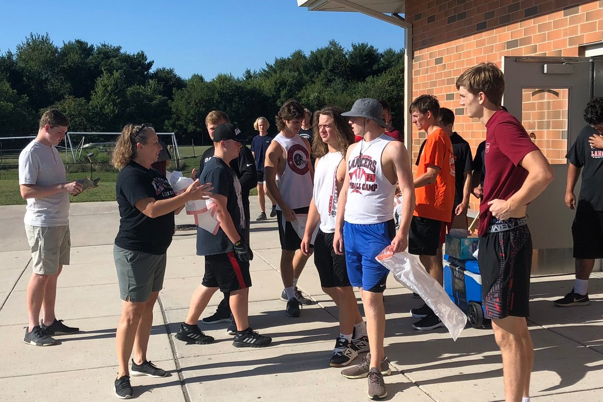 Sport Booster Lori Gardner give players instructions on how the day will run.