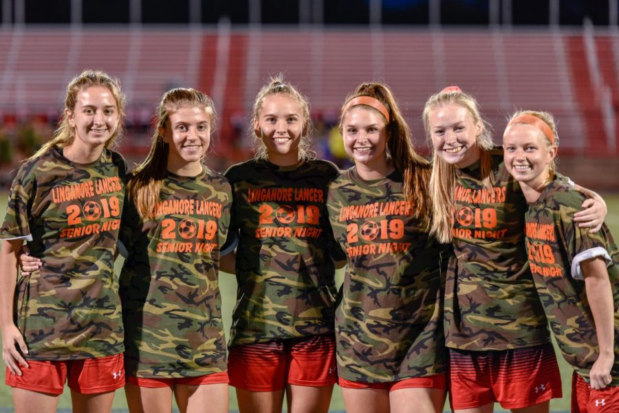 The+six+seniors+pose+for+a+picture+after+their+speeches+right+before+the+game.+