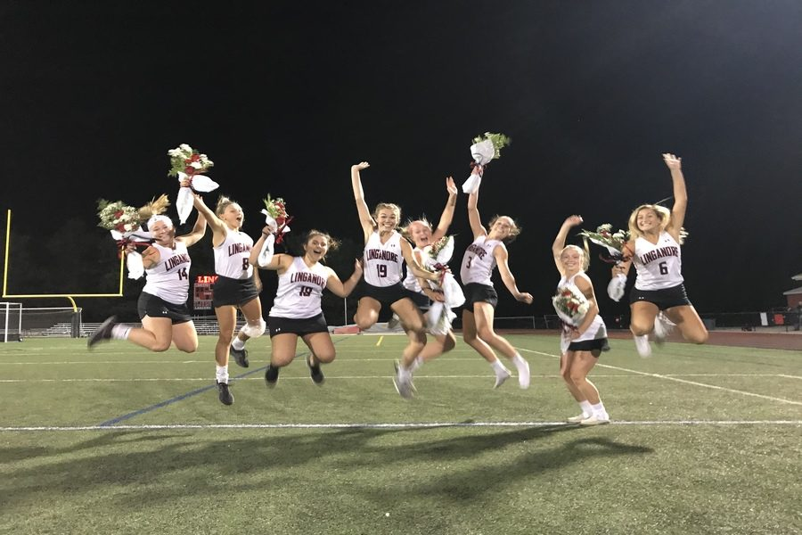 The senior varsity field hockey players jumped for joy to celebrate their last regular season home game.