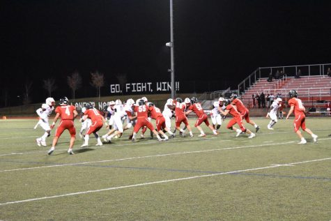 The Penns Grove Red Devils run the ball leading up to another score.
