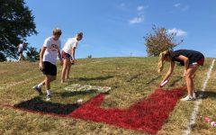 Lancers spray paint their school spirit on hill