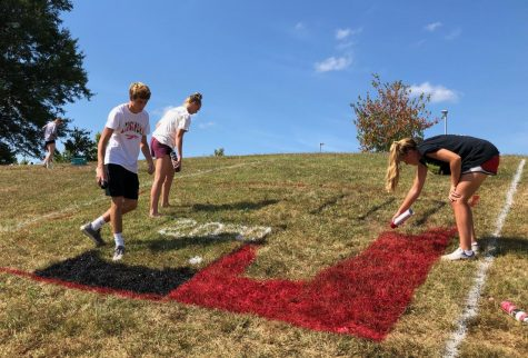 Lancers spray paint their school spirit on hill