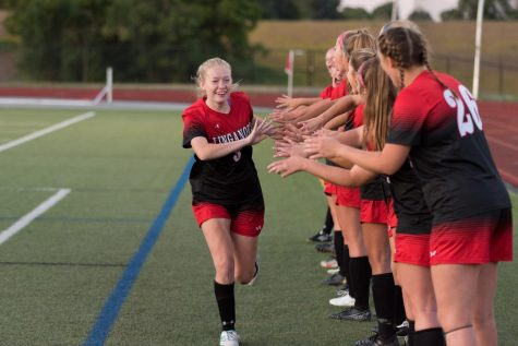 Meghan Mong-Kerwin celebrates with her teammates.