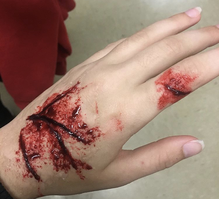 Junior, Mackenzie Berry, shows off her work from the blood and gore workshop