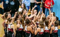 Varsity cheer performs their way to the Grand Champion title: Photo of the Day 10/16/19