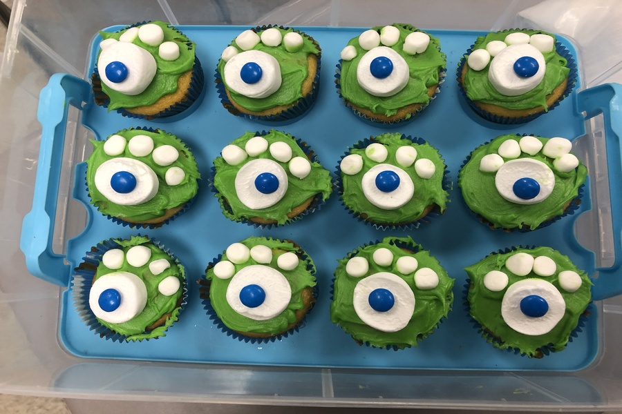 Mrs. Rebetsky makes monster cupcakes for the journalism students.