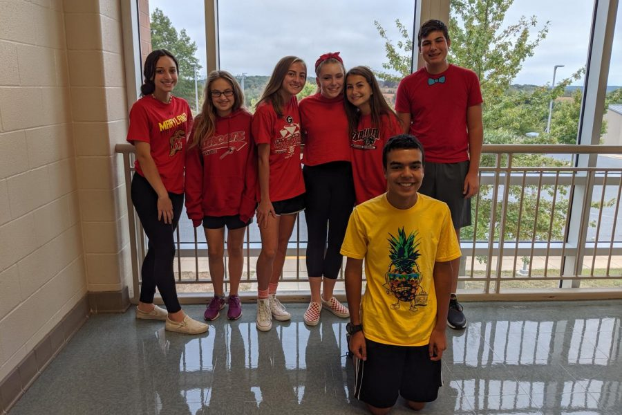 Thursday: Mrs. Leane Pupo's class shows off their red for class color day.