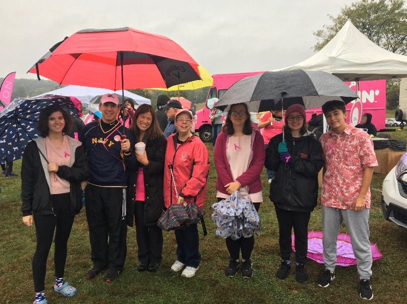 Members of Linganore's Key club gather in the rain prior to the start of the walk