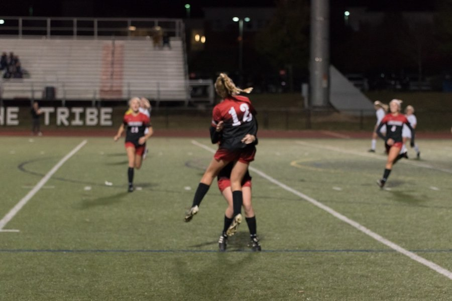 Taylor Ferguson and Nora Salter celebrate after Ferguson's goal to tie the game.