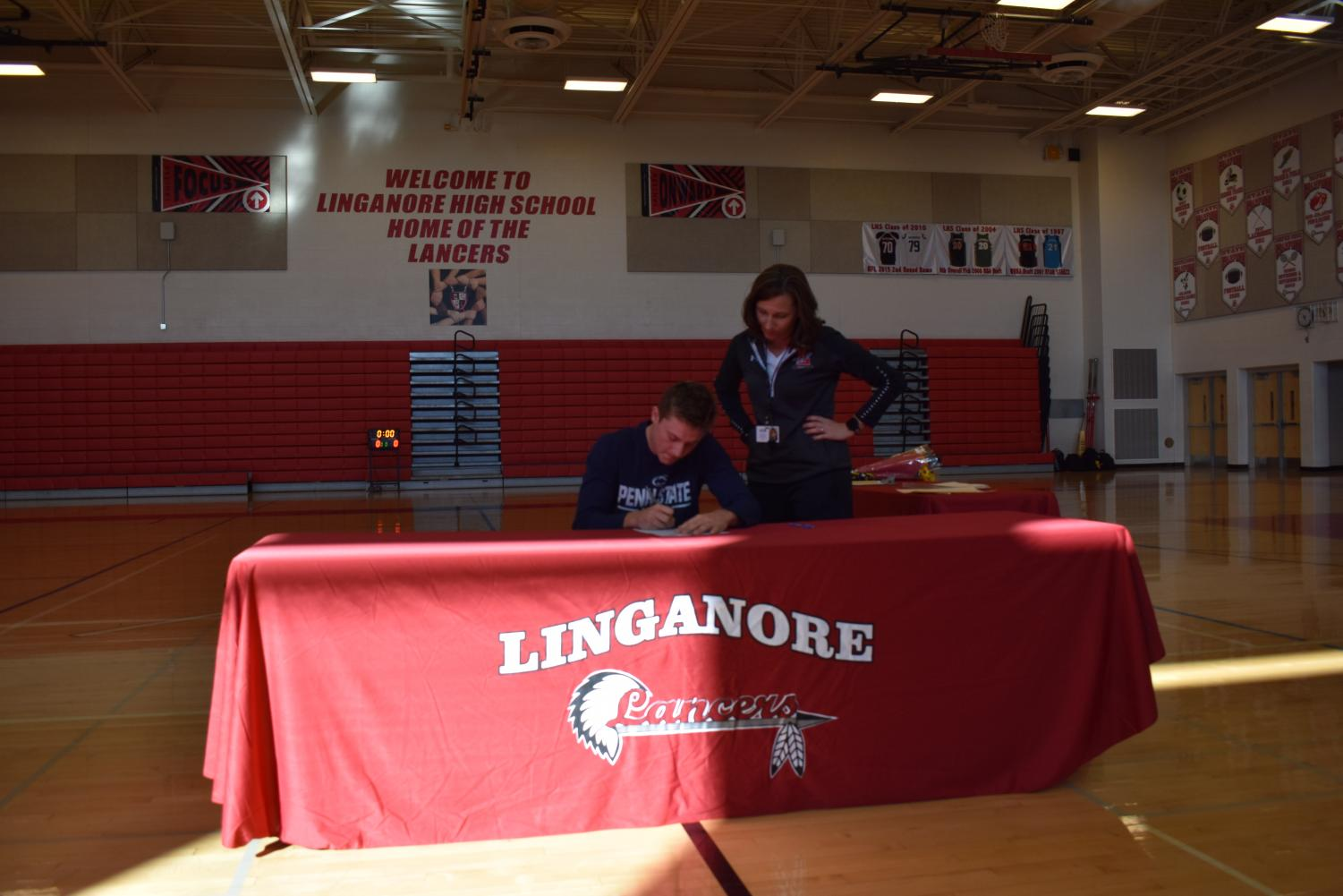 Ryan Barthlow signs his National Letter of Intent