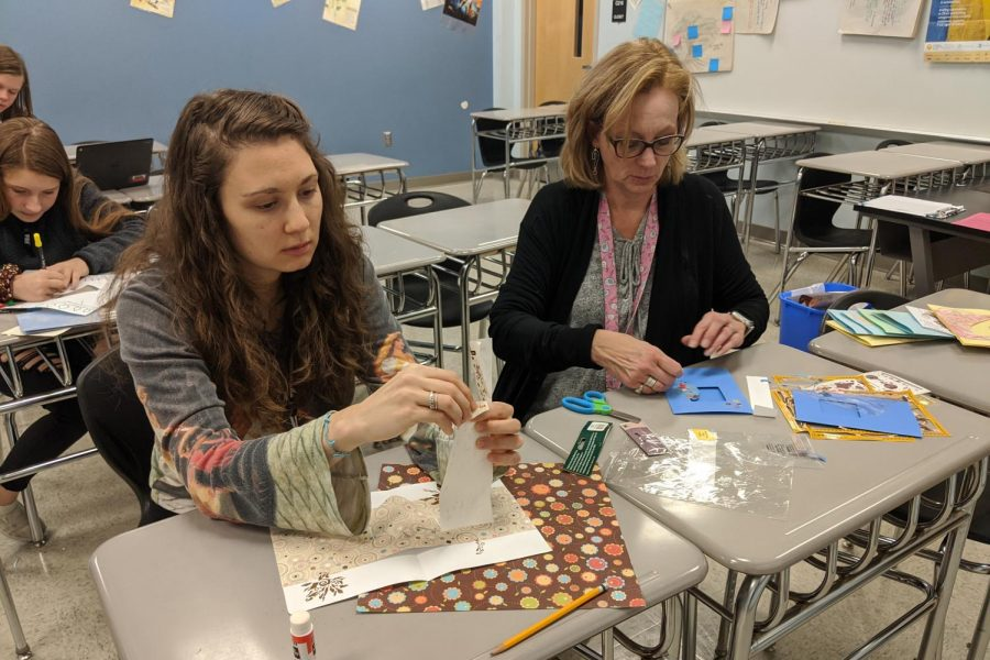 English teachers Mary Troxel and Natalie Rebetsky make cards for the elderly.