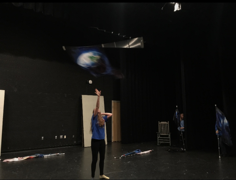 Hannah Charles practices with her flag.