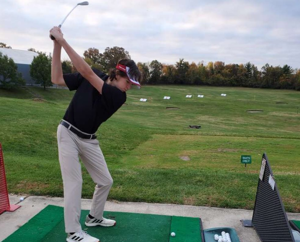 Senior Vince Booth practices hitting moments before start of the Maryland State Golf Tournament