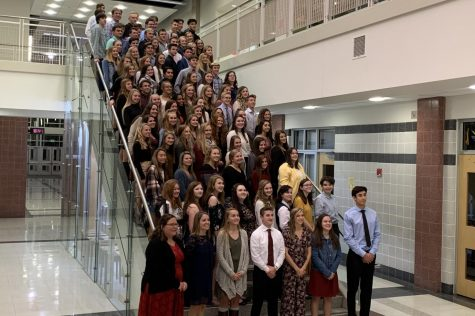 All NHS members, officers, and advisers pose for a picture for the yearbook on the steps on Main Street.