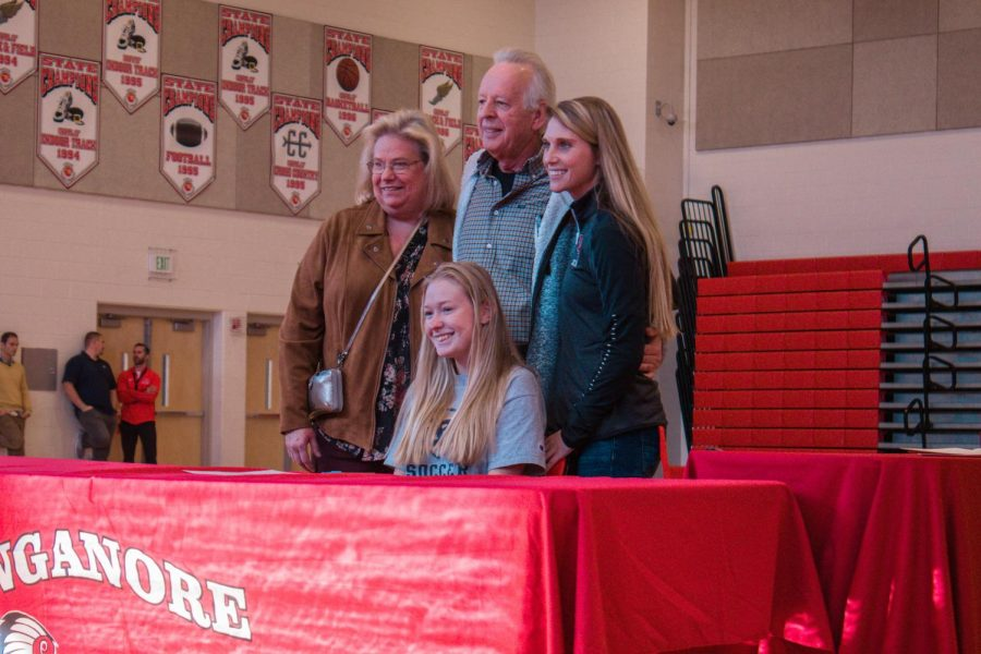 Meghan poses with family and coach after signing to Emory and Henry.