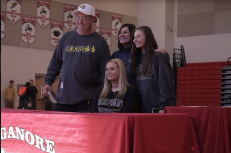 Ellie poses with family after signing her National Letter of Intent.