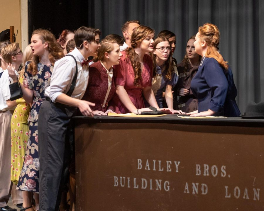 The towns-people of It's a Wonderful Life confront Mrs. Bailey at the Building and Loan.