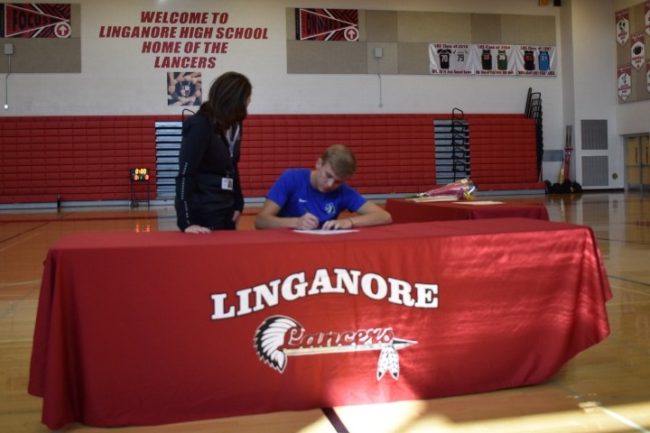 Guided by Rachel Easterday Garrett Schwartzbeck signs his National Letter of Intent to play baseball at Elizabethtown College