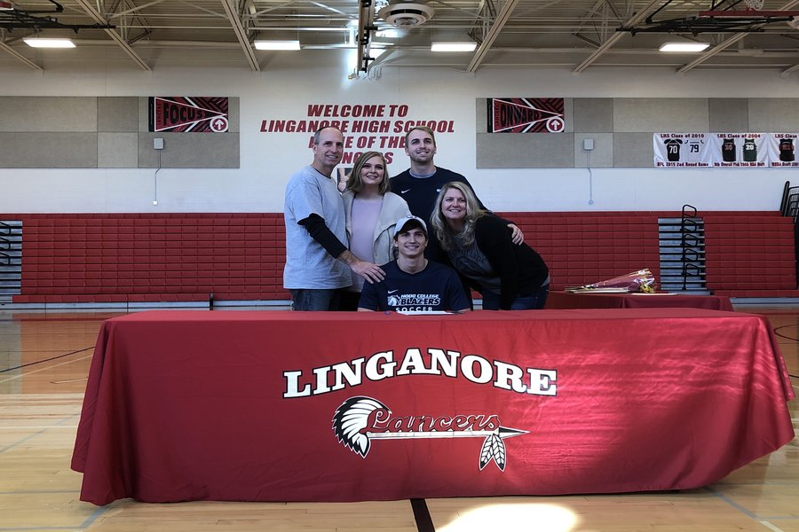 Braden Weinel poses with his family after officially signing to Hood College.