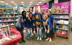 NEHS members shop for baskets of books for needy elementary school families