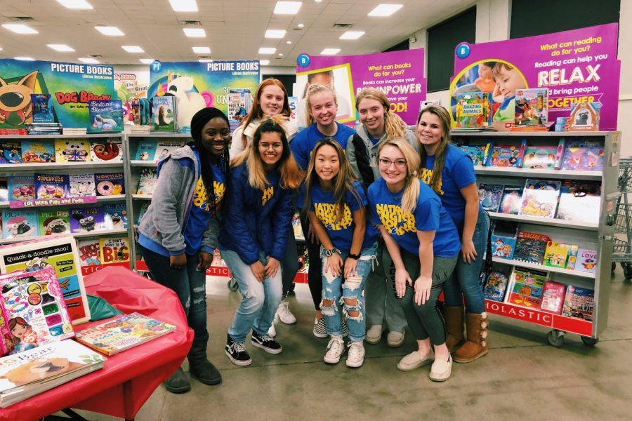 NEHS members pose at the Scholastic Book Fair
