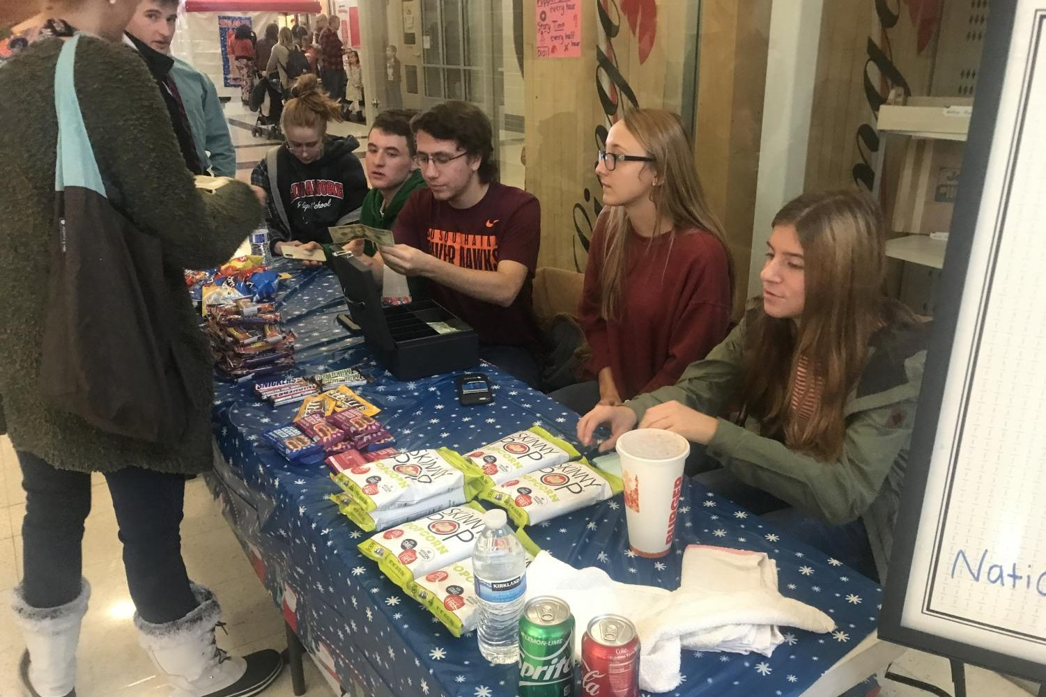 Business Honor Society sells snacks to raise money for families in need.
