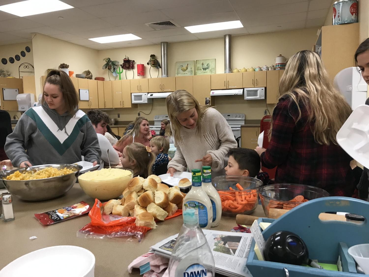 Little Lancers celebrate Thanksgiving with their buddies.