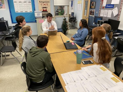 Lancer Media editors get advice from reporter Katryna Perera.