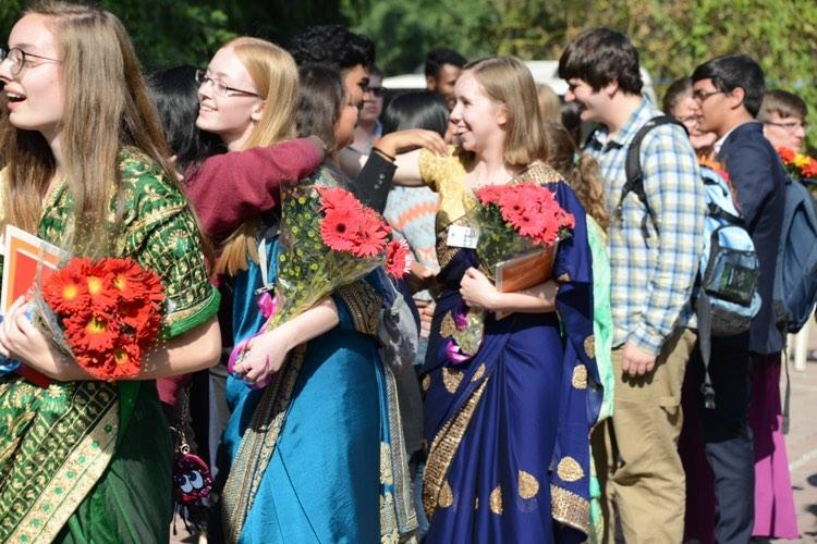 Leah Stucke (NY), Madeline Klein (NY), Elizabeth Anderson (MD), Zack Visker (NY), and Nito Slack (MD), say goodbye to youth at Apostles Methodist Church in Delhi, where they were given flowers and books as well as tea and snacks.