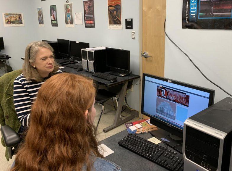 Editor Emily Webb shows Dr. Elizabeth Atwood The Lance website.