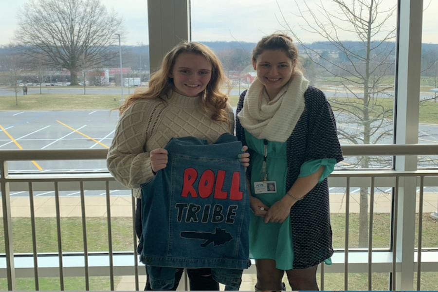 Advisor Ms. Mary Troxel and Carolina Heister pose with a roll tribe jean jacket.