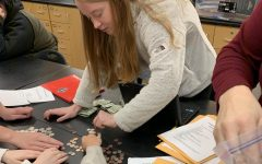 Sophomore Erika Moore counts donations.