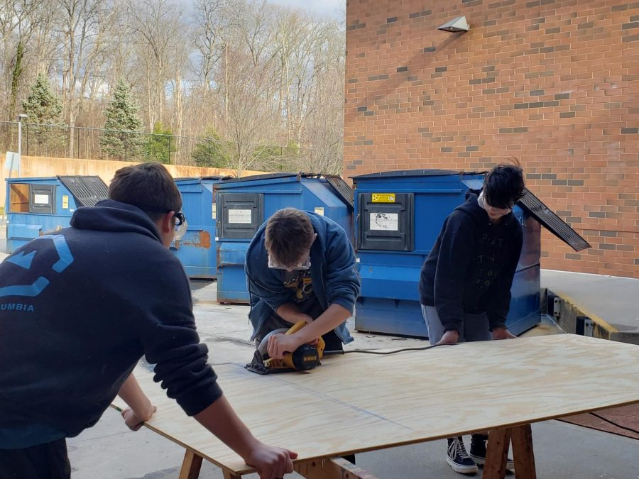 Tables, platforms, and backdrops–Techies work skillfully to make the set of Newsies: Photo of the Day 2/13/20
