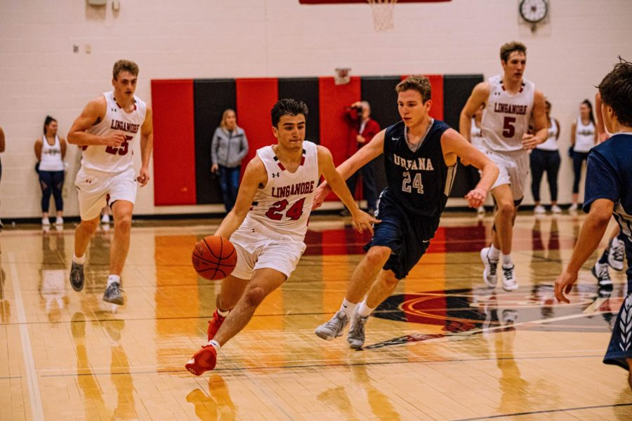 Junior guard Francisco Palacios blows past defenders during a fast break late in the third quarter