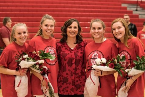 Hannah Ratchford, Amanda Lindsay, Taylor Ferguson, and Sarah Curley are recognized by Coach Rachel Easterday on senior night.